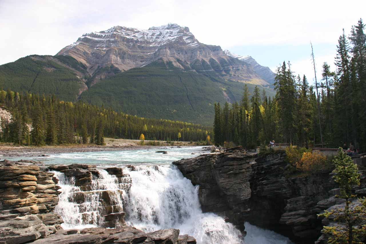 The brink of the Athabasca Falls with mountain backdrop