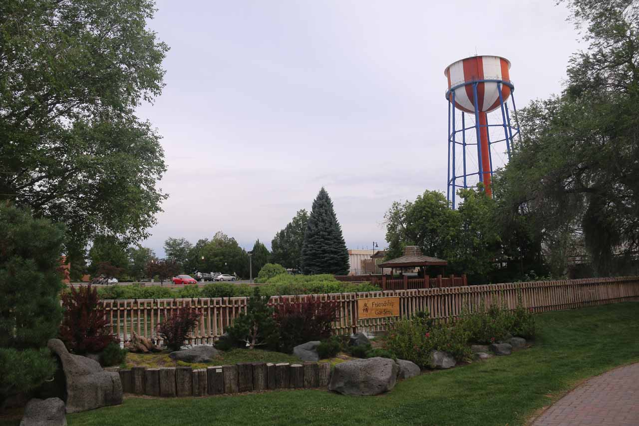 Looking towards some parking lot and water tower from within the Friendship Park