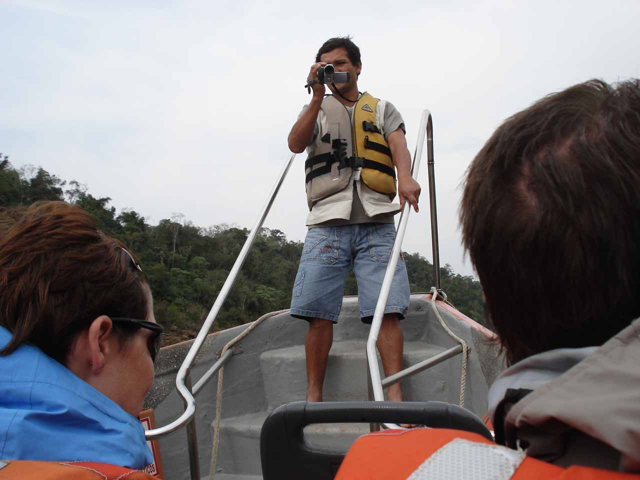 Employee at front of the boat shooting the whole experience