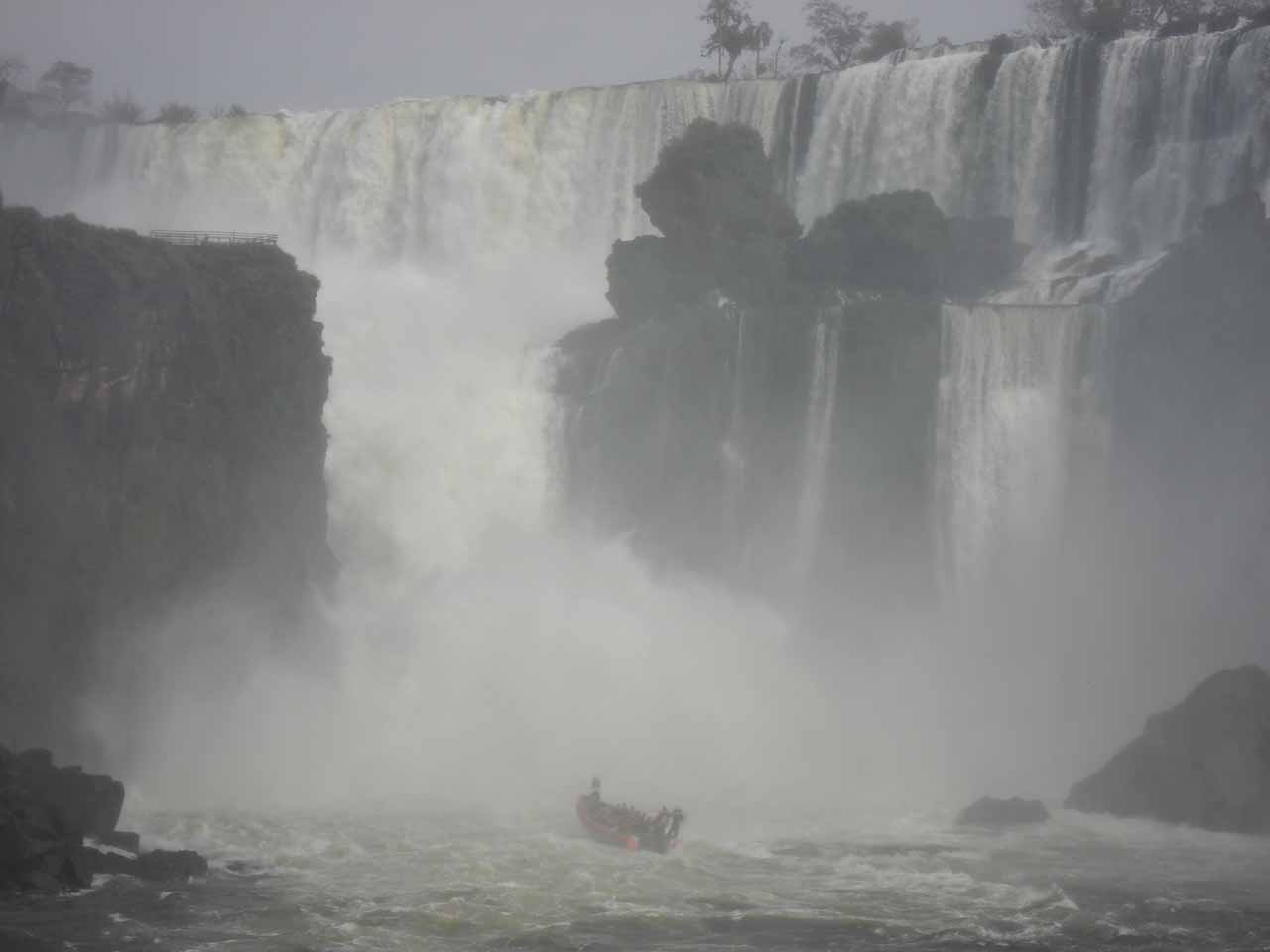 A boat getting drenched under Salto San Martin