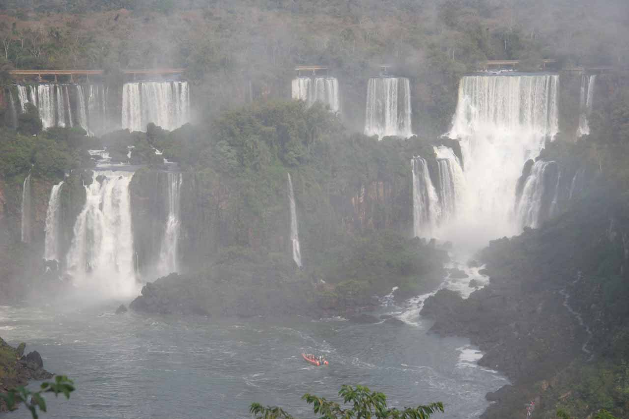 One of the boat tours dwarfed by the falls