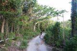 Ile_des_Pins_058_11262015 - Julie on the garden path in search of the Piscine Naturelle