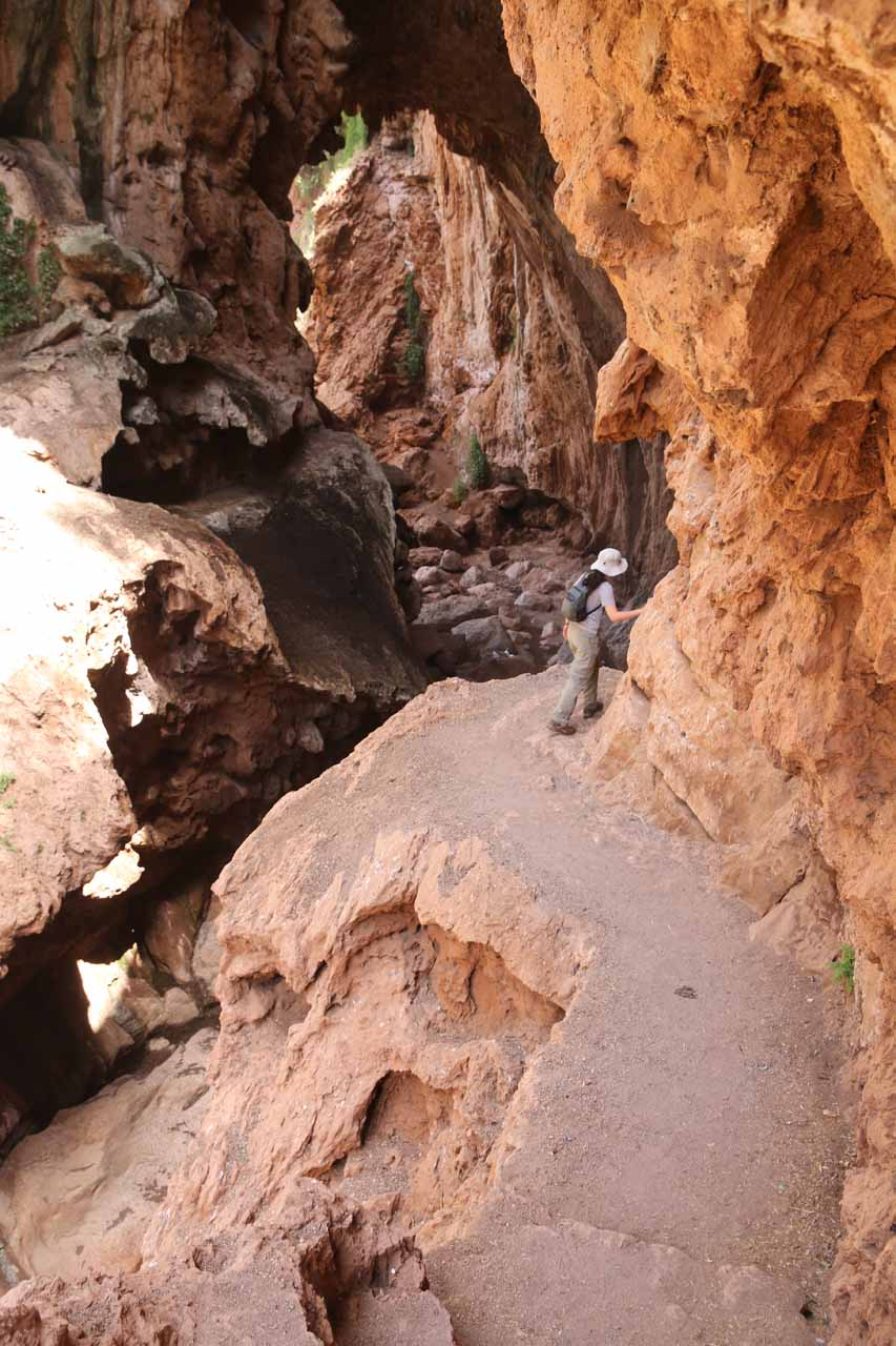 Julie staying away from the dropoffs as she followed the ledge trail through the Imi n'Ifri Natural Bridge