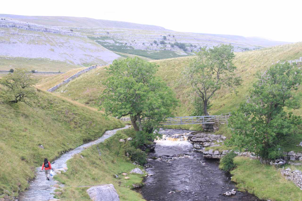 Julie approaching the Kingsdale Beck with threatening weather on the way