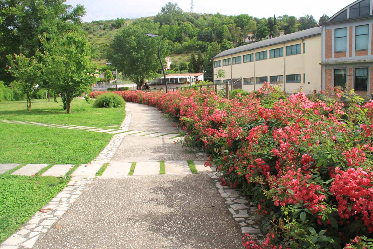 On the flower-lined walkway through the park leading to Cascata Valcatoio