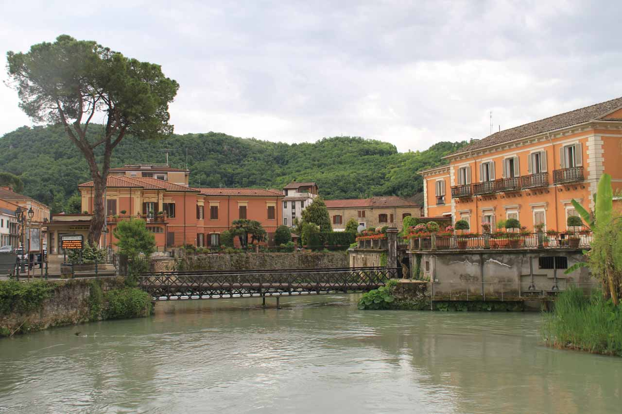 Pretty view of some important-looking buildings fronted by a footbridge at Isola del Liri