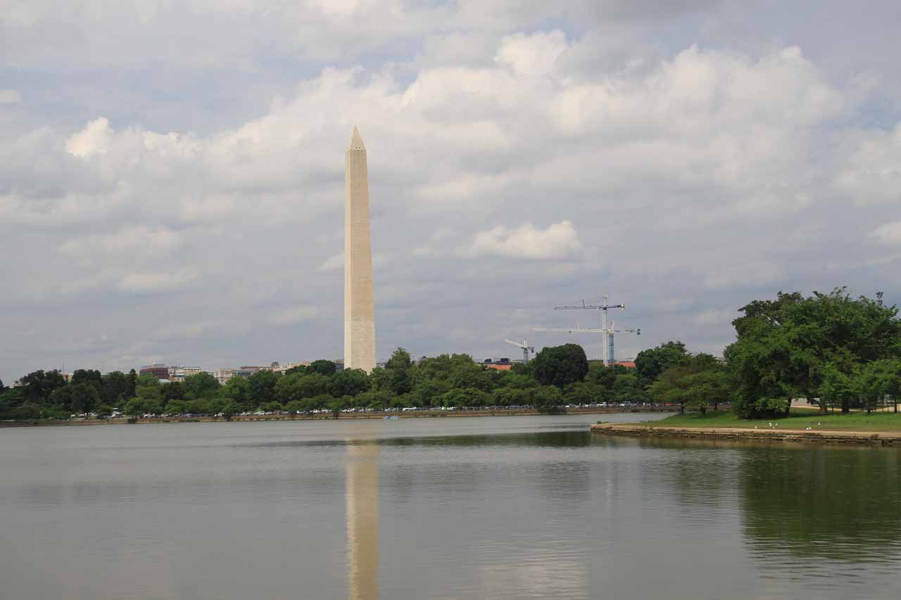 The Washington Monument across the Potomac with threatening thunderclouds above
