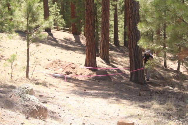 Jemez_Falls_061_04152017 - Pink police tape on the shorter side of the loop walk leading from the Jemez Falls Day Use Parking Lot to its overlook