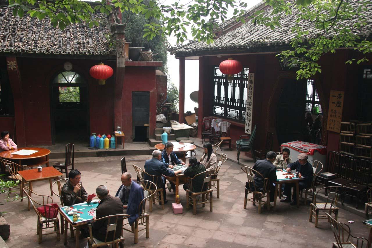 People spending their siestas playing cards or mahjong