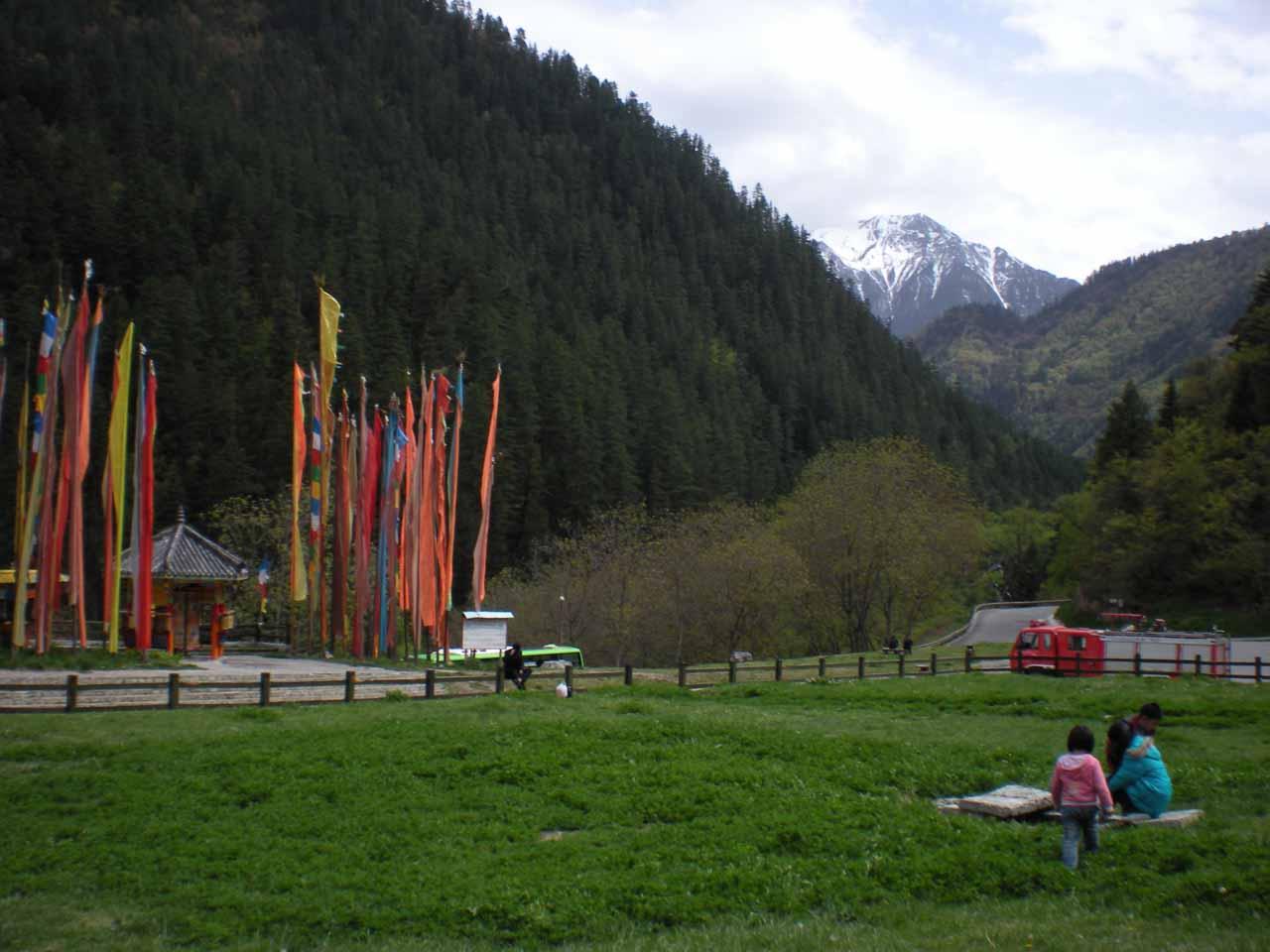 Prayer flags before the alpine scenery near Shuzheng Village
