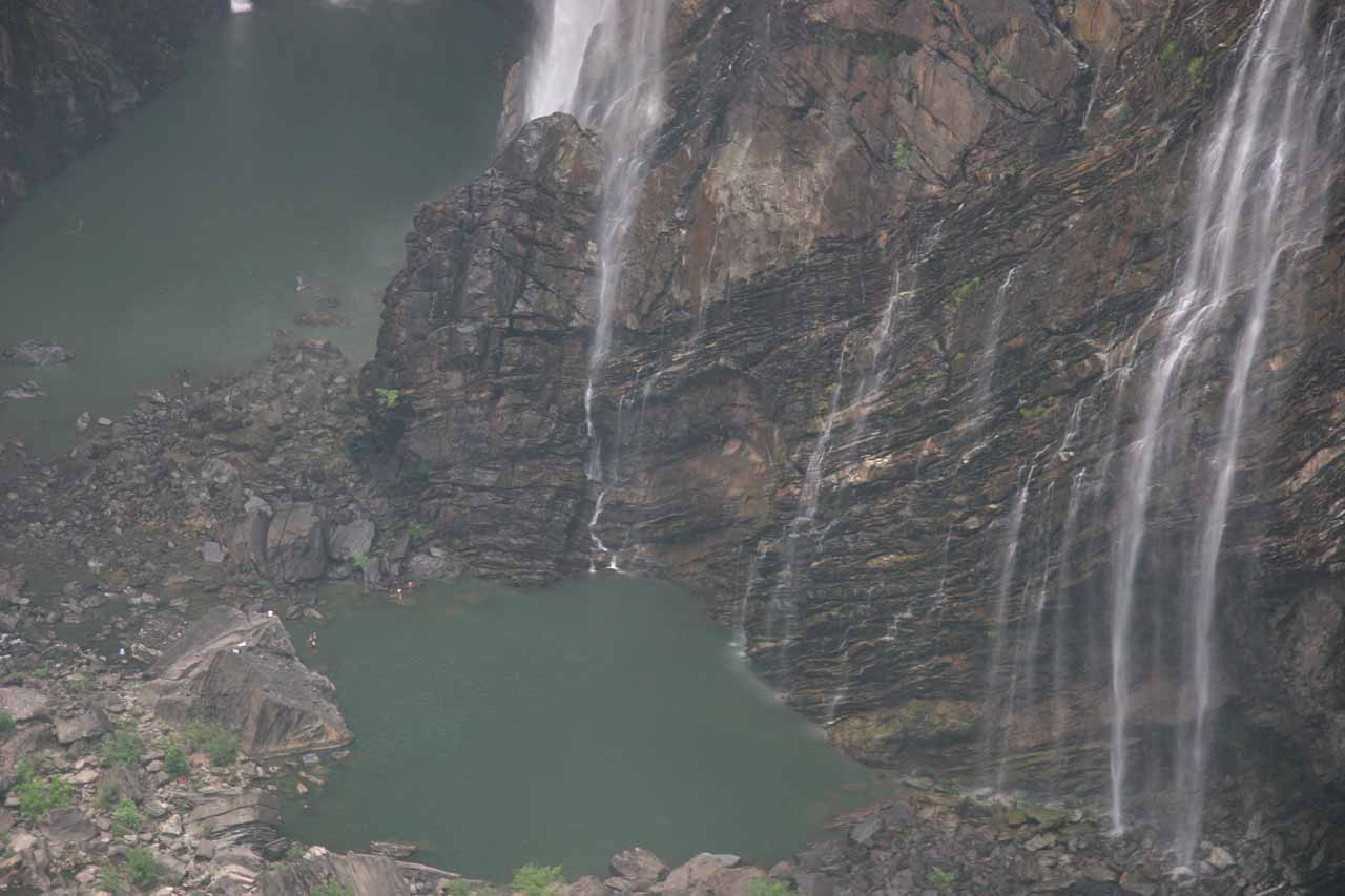 You have to look real closely at this photo in order to even see people swimming at the plunge pool beneath Jog Falls