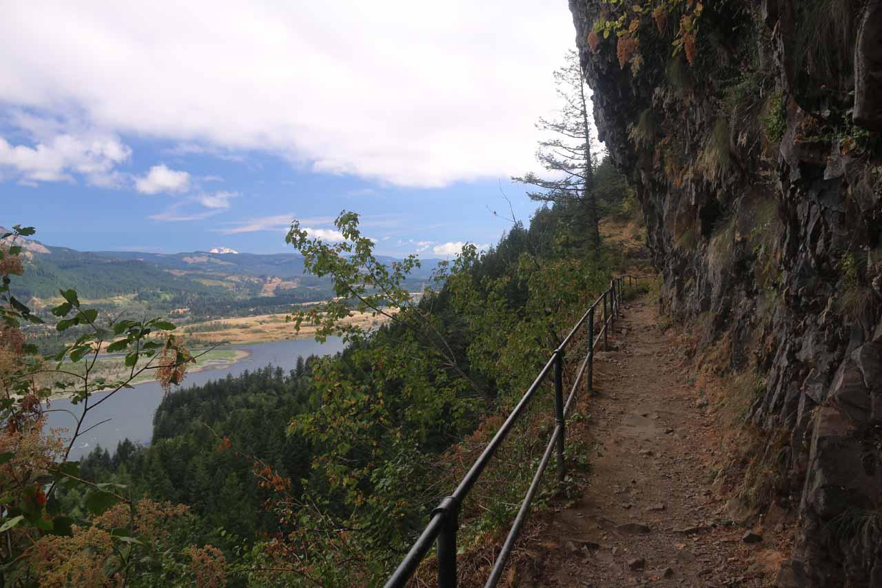 Following along the narrow cliff ledge adjacent to vertical basalt cliff walls