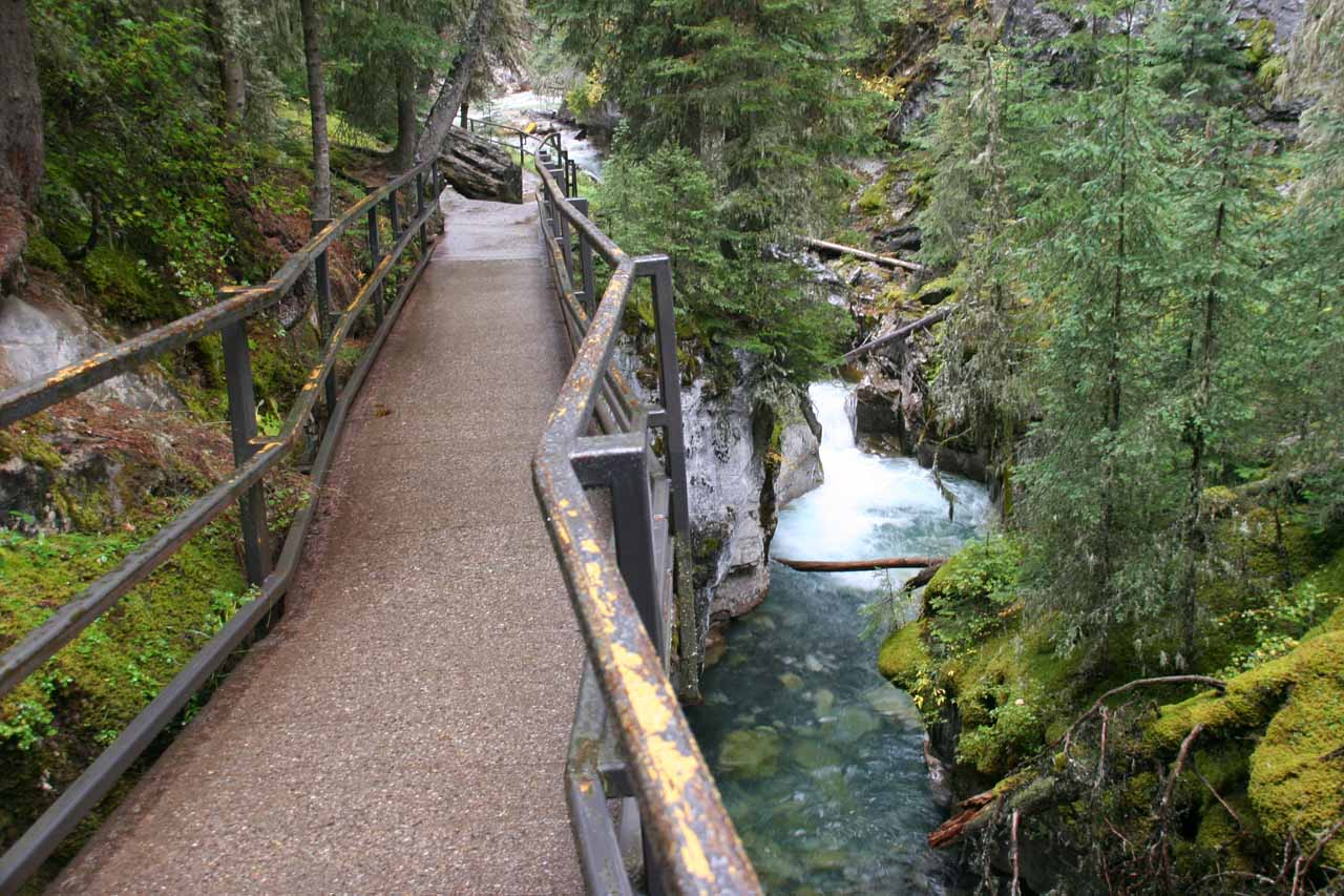 Walking on an elevated walkway with small cascades below