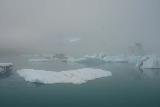 Jokulsarlon_197_08092021 - Looking into the fog towards some large chunks of icebergs within Jokulsarlon