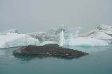 Jokulsarlon_204_08092021 - Looking towards a dirty ice piece backed by other bluish icebergs within Jokulsarlon