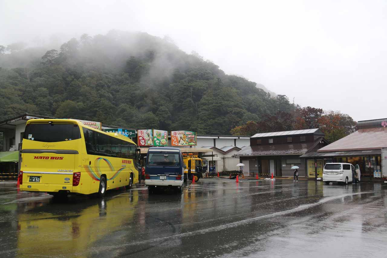 The spacious car park for the Joren Falls fringed by some shops and cafes