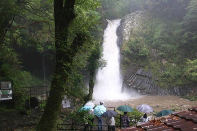 Joren_Falls_050_10162016 - People donning umbrellas to shield themselves from the rain while experiencing the Joren Waterfall