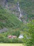 Jostedalen_019_jx_06282005 - Yet another waterfall in Jostedalen.  This one was thin and tall and it was the backdrop behind the farms and homes seen in the foreground of this photo