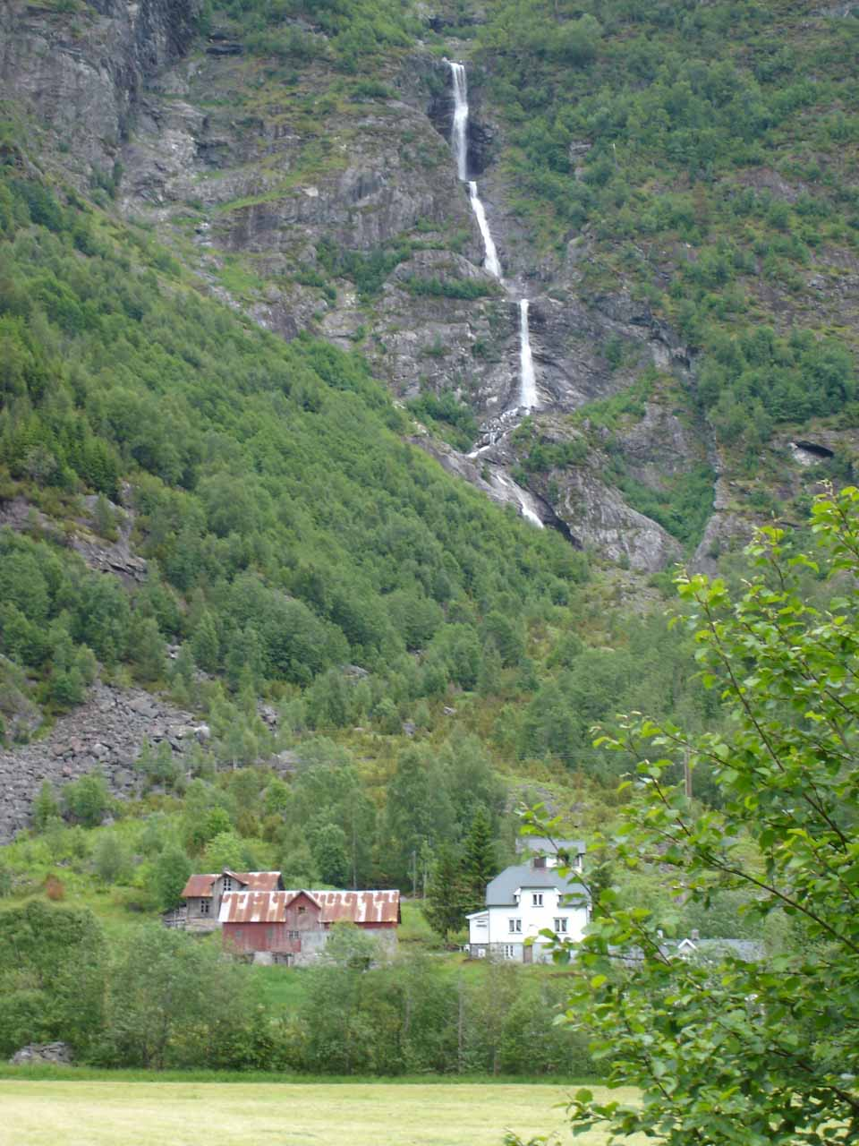 Yet another waterfall in Jostedalen.  This one was thin and tall and it was the backdrop behind the farms and homes seen in the foreground of this photo