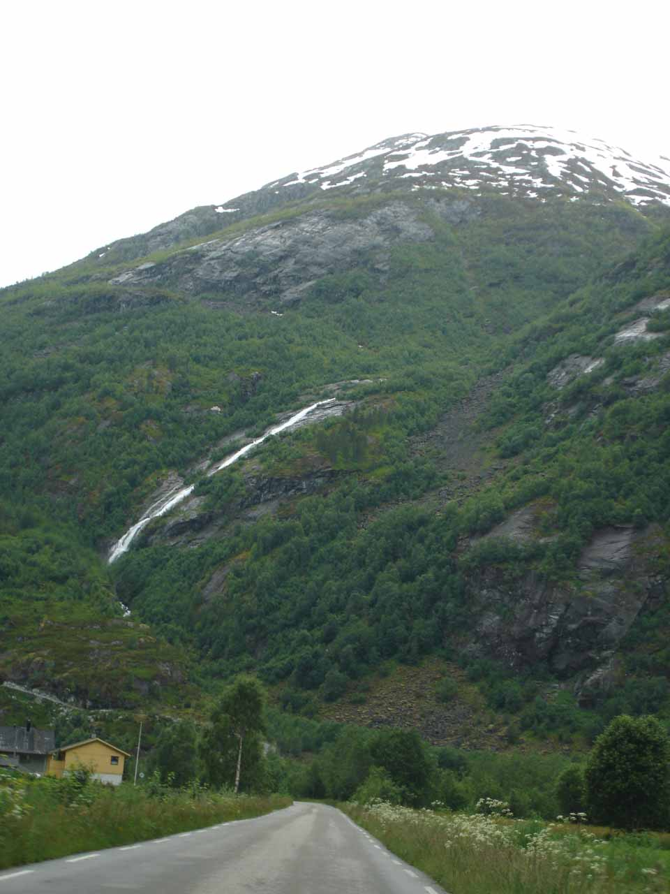 This was another tall and sliding waterfall we noticed in Jostedalen while going south on Road 604.  By now, we were getting waterfall-fatigued