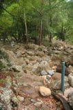 Jourama_Falls_010_05142008 - Walking on slippery rocks near the edge of the stream