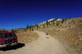 Judd_Falls_008_10162020 - Julie starting to ascend the rough road from the lower parking area to the upper parking area and the Judd Falls Trailhead