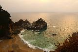 Julia_Pfeiffer_Burns_SP_049_11172018 - Looking across the McWay Cove and McWay Falls from the end of the open part of the trail during our November 2018 visit, which was just as the sun was trying to break through the marine layer