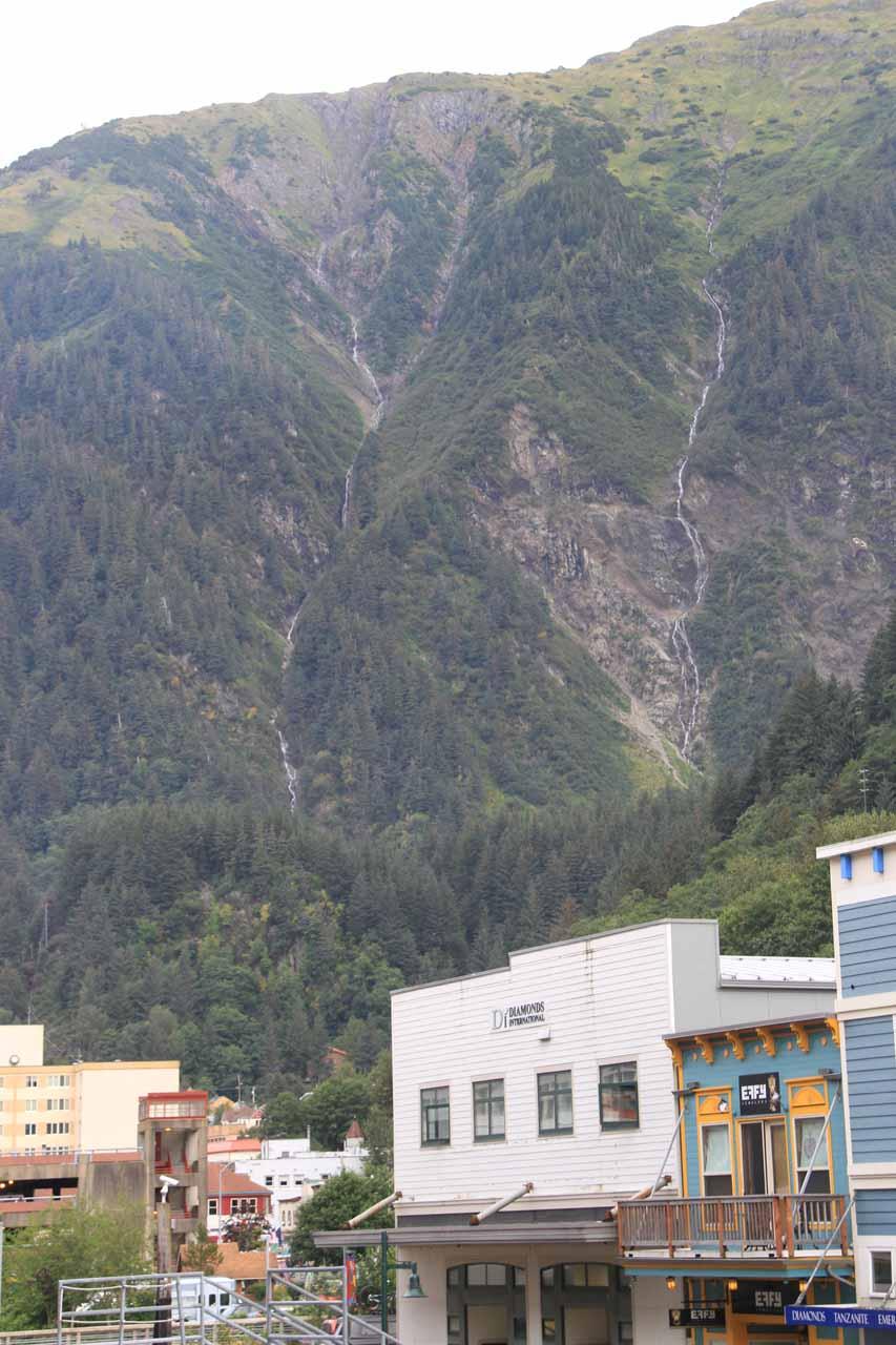 Pair of thin cascades behind downtown Juneau