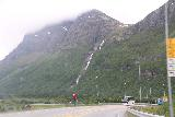 Kafjorden_053_07072019 - More frontal view of the tall waterfall near the head of Kafjorden while driving the E6