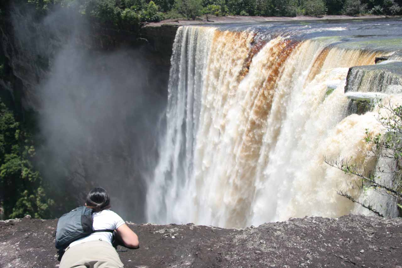 Another look at Julie carefully peering over the edge with Kaieteur Falls in the background