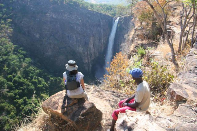Kalambo_Falls_066_06022008 - Julie and our guide admiring the Kalambo Falls against the late morning sun