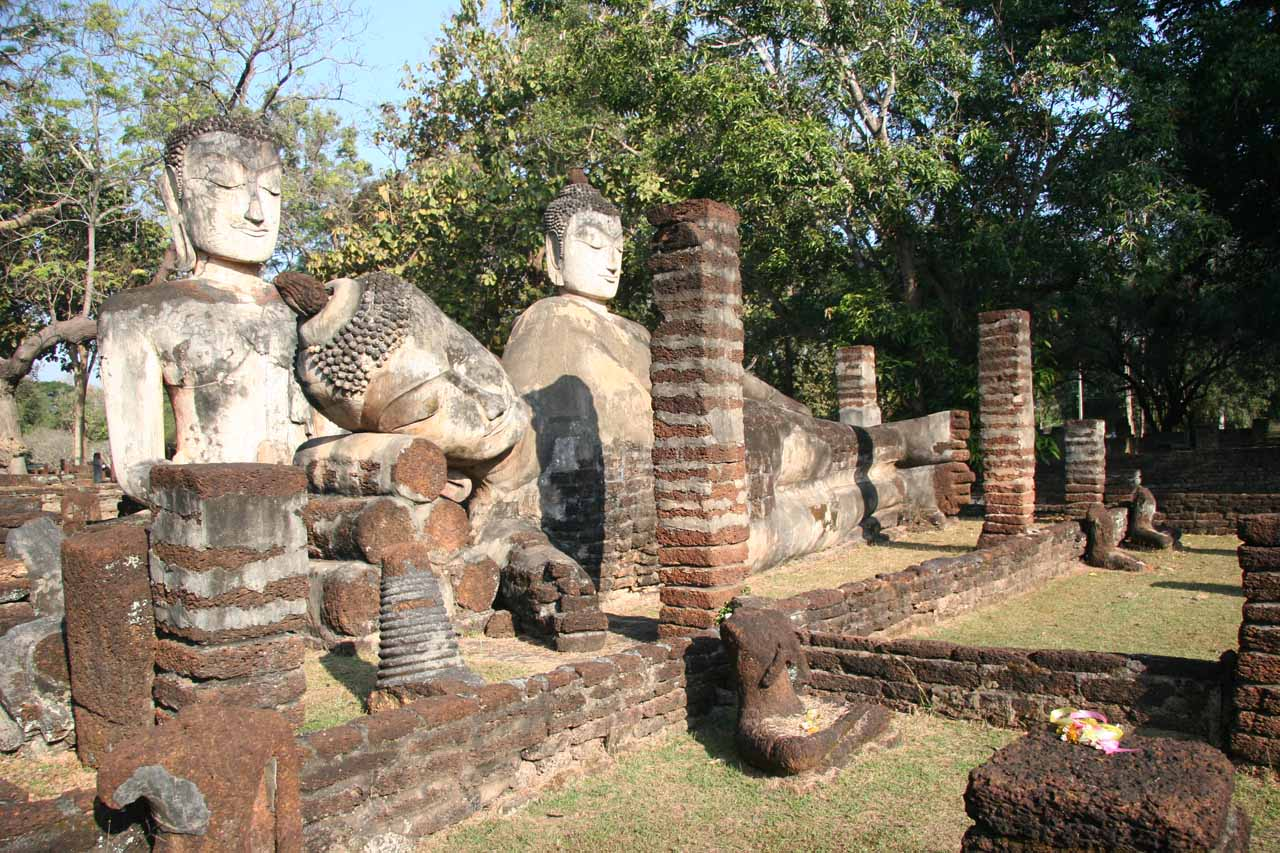 A trio of Buddhas (including a reclining one) at the Kamphaeng Phet Historical Park