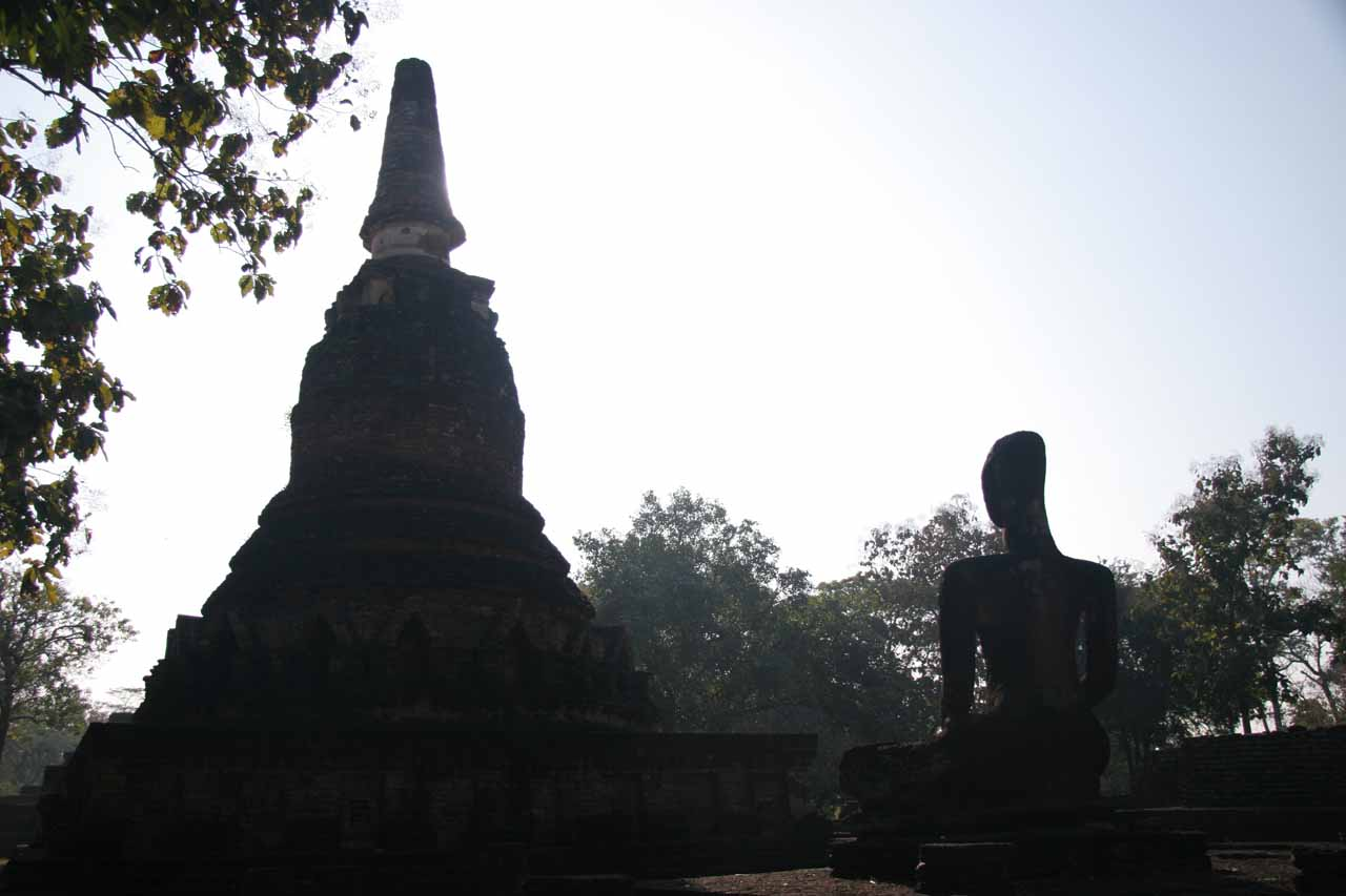 An alien-looking Buddha checking out a chedi