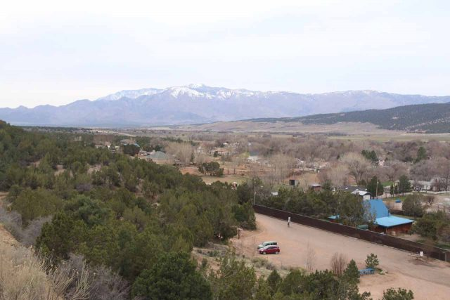Kanarraville_Falls_012_04052018 - Looking back across the parking lot and the town of Kanarraville towards the I-15 and snow-topped mountains across the valley