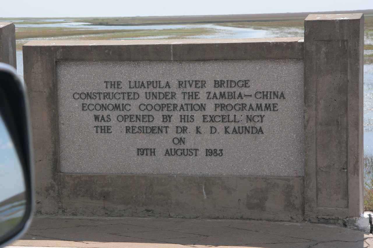 Sign of Chinese-built bridge through scenic swamplands