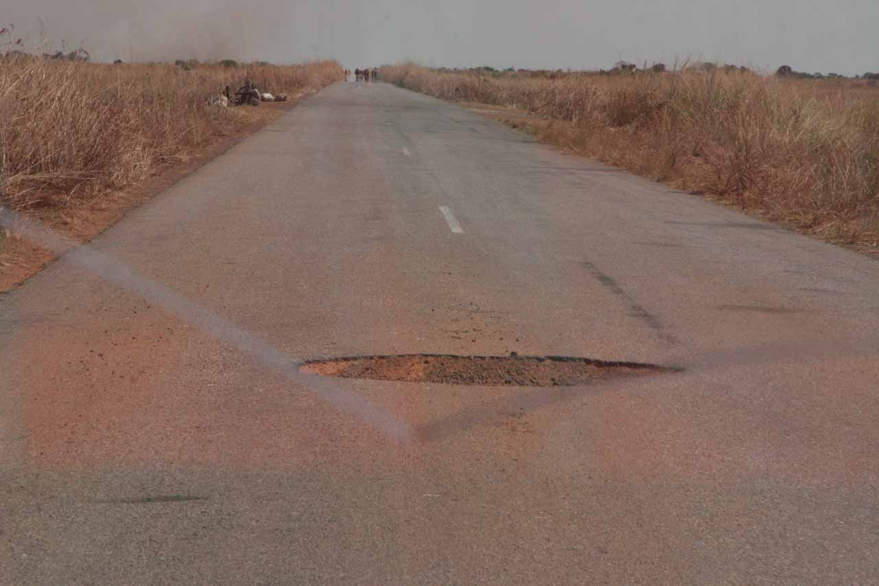Potholes like this are everywhere on Zambian roads