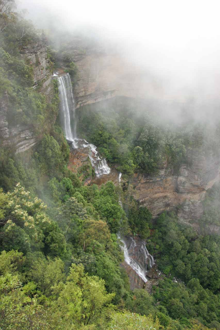 Katoomba Falls momentarily revealing itself from the rising clouds