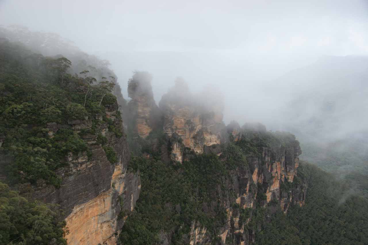 The Three Sisters momentarily revealing themselves from the rain clouds