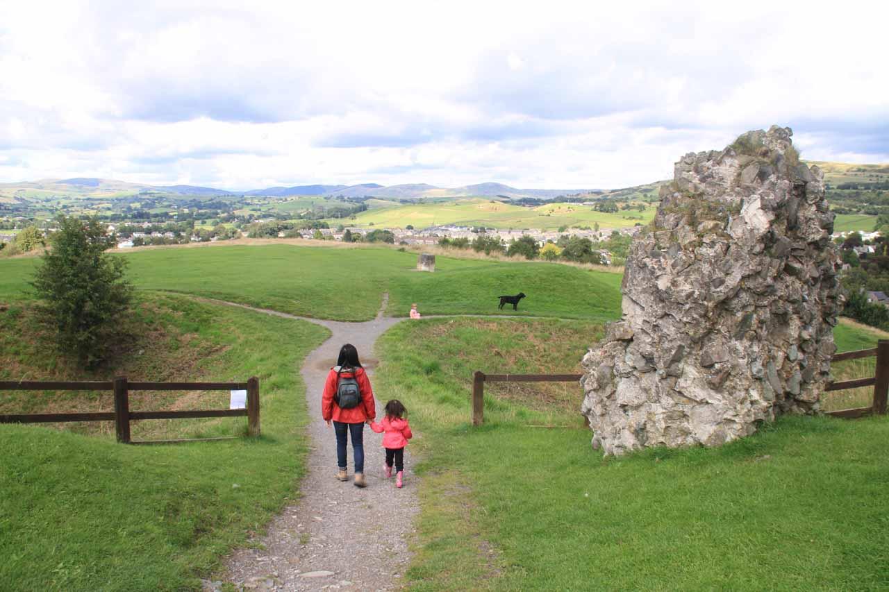Julie and Tahia walking amongst the Kendal Castle ruins