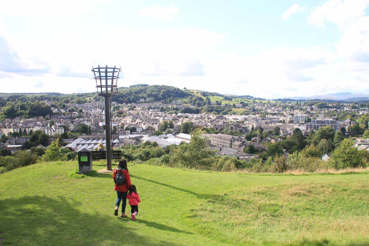 Julie and Tahia approaching the downhill trail back to the car park with Kendal in the distance