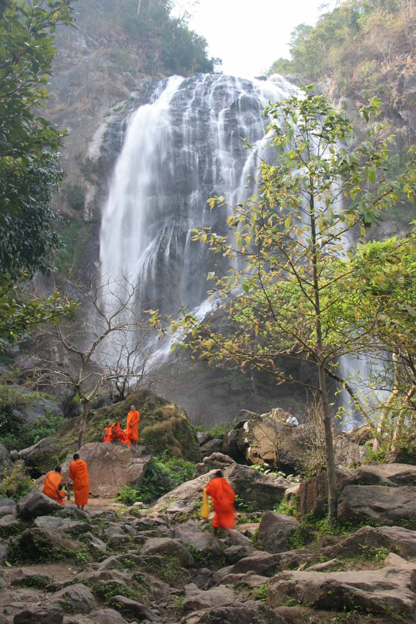 Monks at the base of the falls
