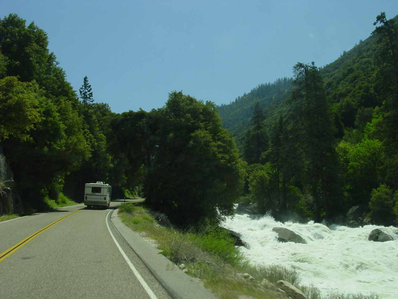 Driving the Kings Canyon Highway 180 towards Cedar Grove as the road follows a raging Kings River