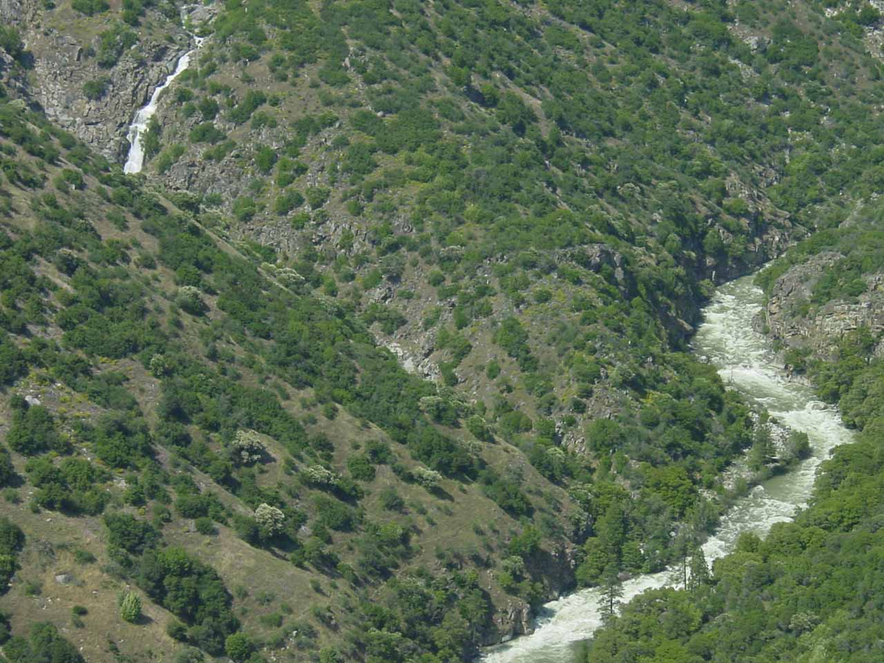 Partial view of a waterfall spilling towards one of the forks of the Kings River