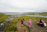 Kirkjufellsfoss_099_08172021 - Julie and Tahia taking time to try to check out Kirkjufellsfoss under suboptimal conditions