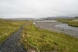 Kirkjufellsfoss_139_08172021 - Context of the downstream path on the less popular side of Kirkjufellsa with Grundarfoss in the background