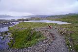 Kirkjufellsfoss_180_08172021 - Looking down at the context of the trail by Kirkjufellsfoss with Kirkjufell and Grundarfjordur in the background