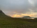 Kirkjufellsfoss_sunset_018_iPhone_08172021 - Looking in the distance towards the setting sun from the trailhead for Kirkjufellsfoss