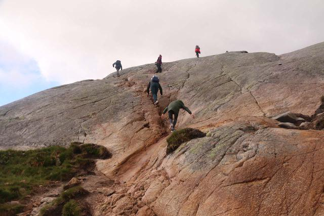 Without proper footwear, slippery and steep granite sections like this would be downright dangerous