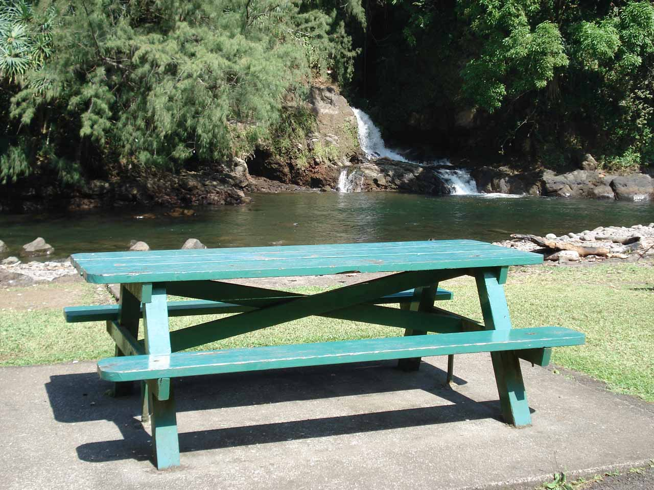 A picnic table before Kolekole Falls, suggesting that this is also a nice little picnic spot