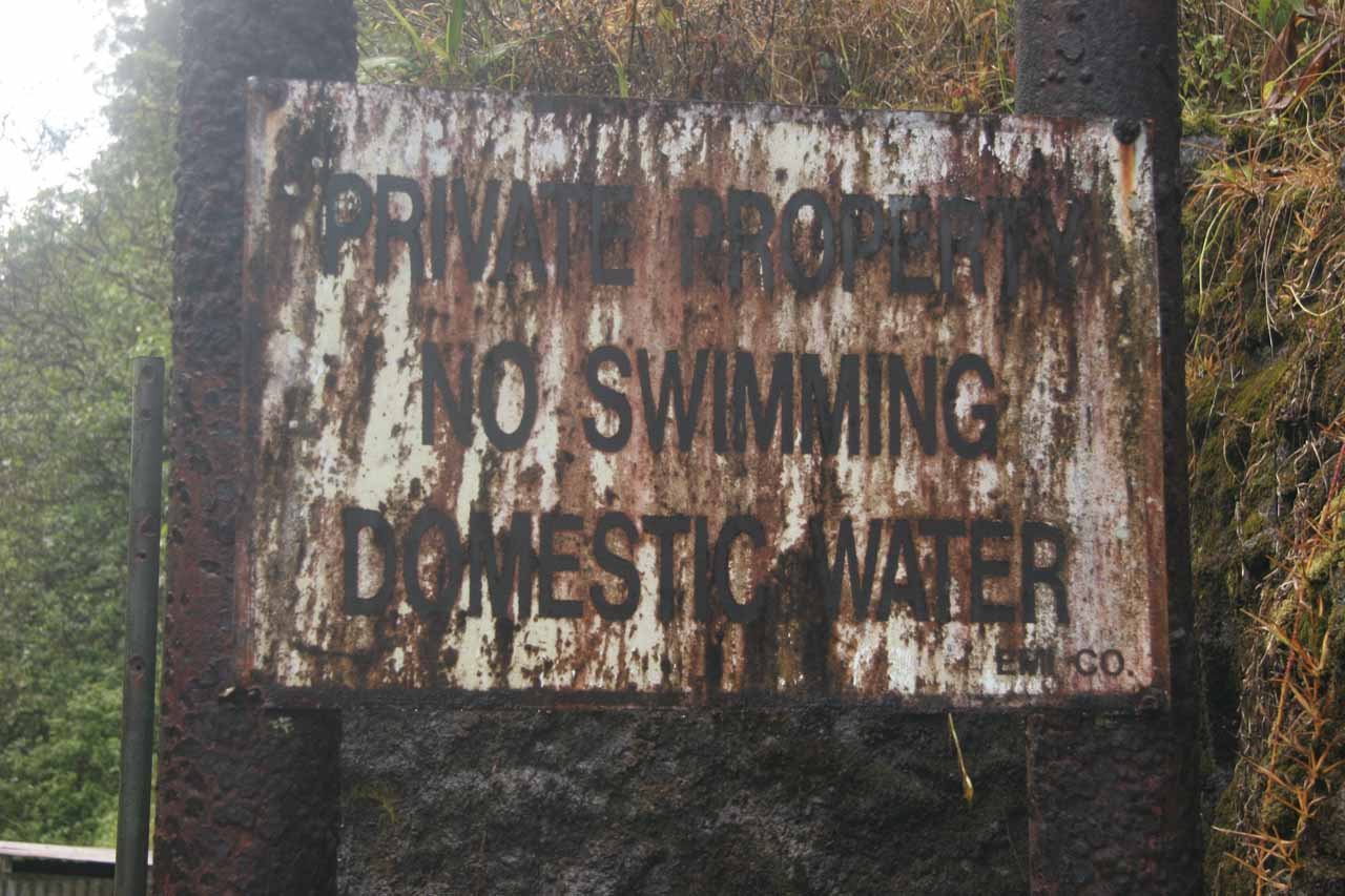 Rusted sign at Kopihula Falls